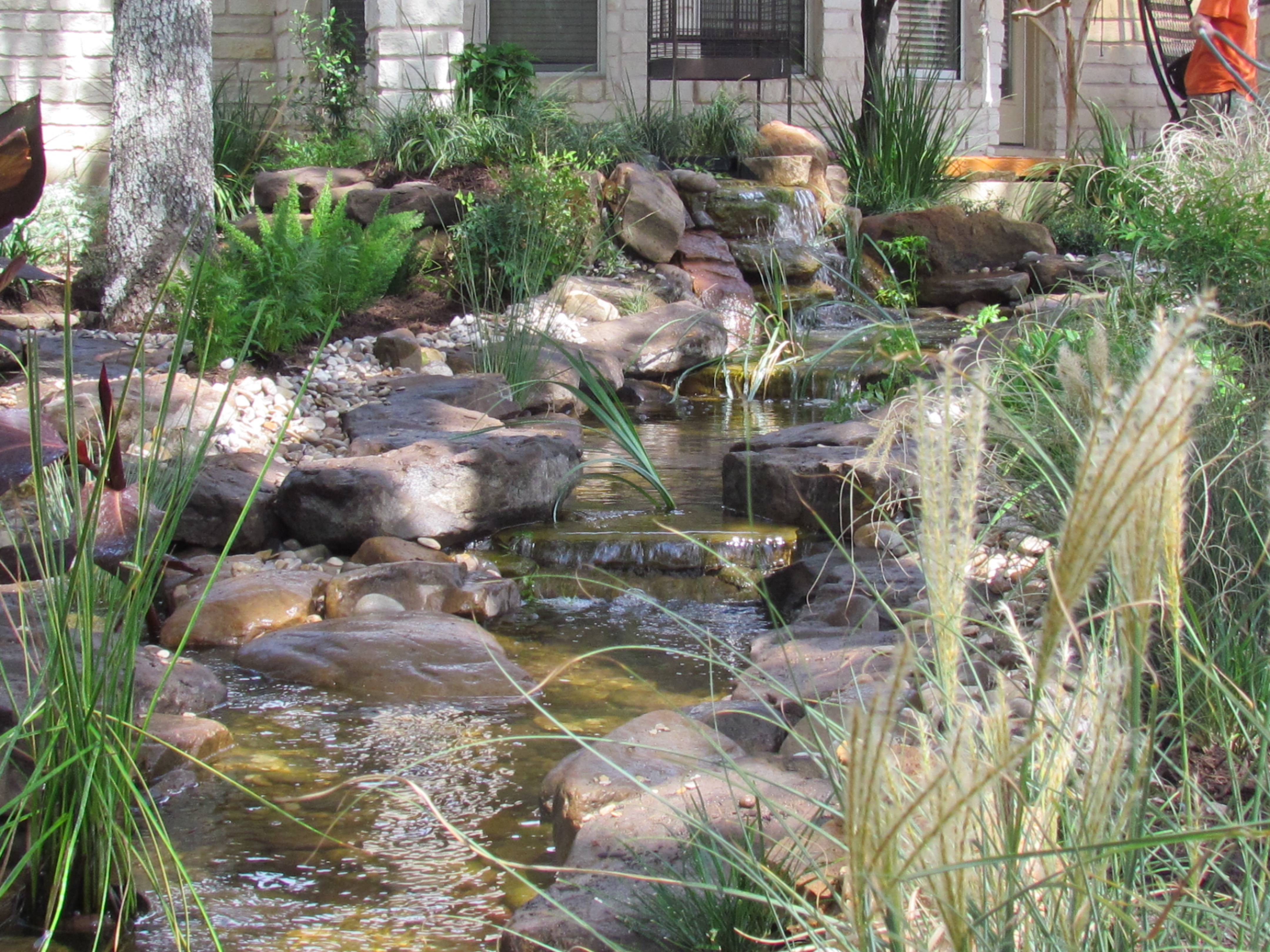 Koi pond pondless waterfall prices for central texas by for Koi pond price