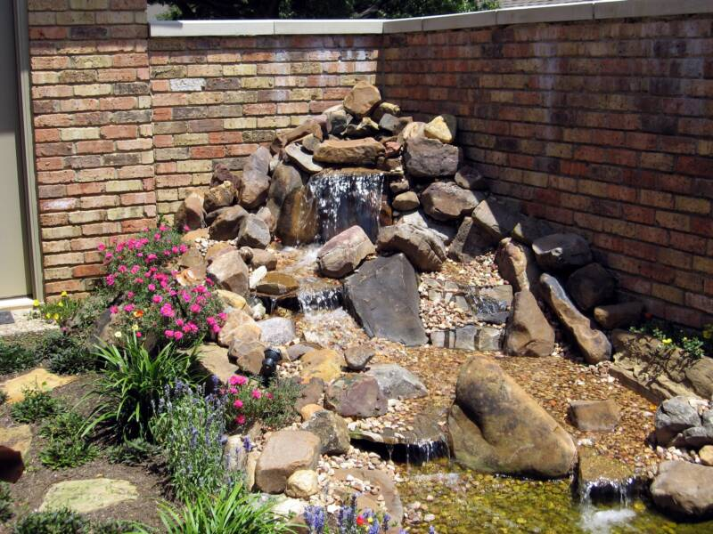Who to choose for a water garden or koi pond austin texas for Koi fish pond rocks